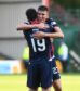 Ross Stewart celebrates with Ross County team-mate Brian Graham.