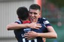 Ross County's Brian Graham (L) celebrates at full time with teammate Ross Stewart