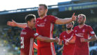 Aberdeen's Sam Cosgrove (centre) celebrates his goal  against Livingston.