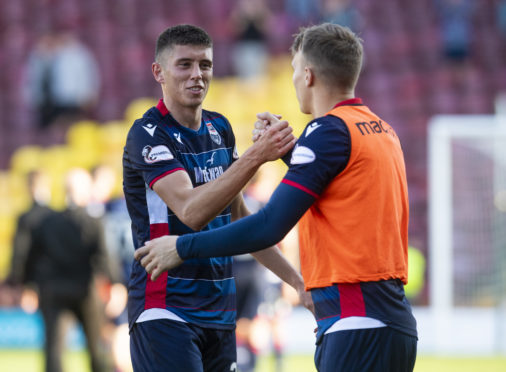 Ross Stewart is congratulated at full time after netting the winner against Motherwell.