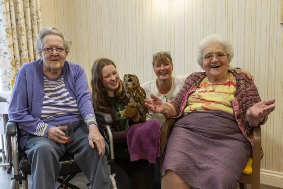 Pictured are residents Dorothy Donald and Marion Jaffray, with Jessica Morrison from Speyside Falconry Centre and Tor-Na-Dee team member Lotte Grooby.