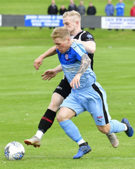 Penalty shout for Turriff as Wick's Alan Hughes appears to nudge Turriff's Robert Ward off the ball