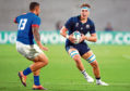 Jamie Ritchie of Scotland runs with the ball under pressure by Alapati Leiua of Samoa during the Rugby World Cup 2019 Group A game between Scotland and Samoa at Kobe Misaki Stadium