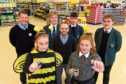 CR0015037 Young Enterprise Scotland (YES) will benefit from a tie-up with Tesco, with shoppers at its supermarkets across the north and north-east being asked to help raise money for it as part of its tokens for charity scheme. Pupils from Hazlehead Academy who are part of the YES programme, Richard Corrigan of Elevator/YES, and Stuart Neil the new manager at Tesco Woodend. Picture of (L-R) Stuart Neil, Chloe Ferries, 17, Sean Paterson, 17, Richard Carmack Corrigan, James Gomes, 17, Beth Reid, 17, Paul Walker, 17.  Picture by KENNY ELRICK     09/10/2019