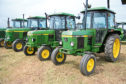 A line up of 1640 2140 and 3040 tractors all fitted with John Deere's SG2 cab at New Deer Show in 2102 when 175 years of John Deere was celebrated.