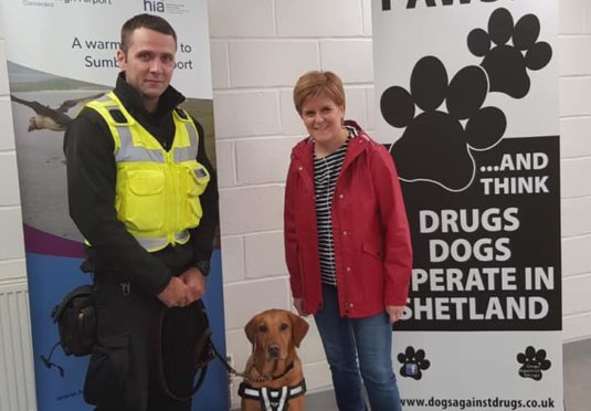 Ewan and Blade on duty at Sumburgh Airport with First Minister Nicola Sturgeon.
