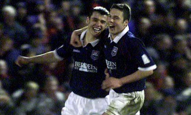 Ross County's Steven Mackay celebrates with Don Cowie during the CIS Insurance Cup, Quarter-final game between Ross County and Rangers at Victoria Park in 2001.