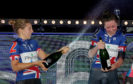 Winners Great Britain's Katie Archibald and Neah Evans celebrate on the podium during day six of the Six Day Cycling.