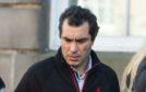 Orhan Mahmudov leaving Elgin Sheriff Court.