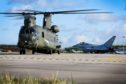 Three Chinook helicopters have arrived at RAF Lossiemouth.