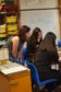 Young women engaging with physics subjects.