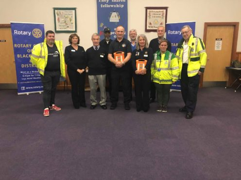 Members of Blackburn Rotary Club, volunteers and residents