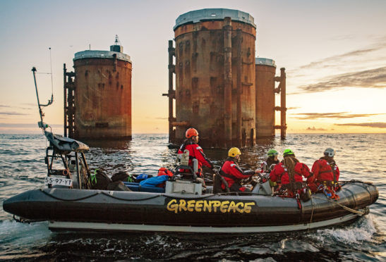Greenpeace activists from the Netherlands, Germany and Denmark boarded two oil platforms in Shell's Brent field today in a peaceful protest against plans by the company to leave parts of old oil structures with 11,000 tons of oil in the North Sea.   Climbers, supported by the Greenpeace ship Rainbow Warrior, scaled Brent Alpha and Bravo and hung banners saying, 'Shell, clean up your mess!' and 'Stop Ocean Pollution'.
