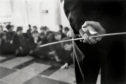 (GERMANY OUT) Great Britain, England, London, Battersea Secondary School, pupils sitting on the floor of the assembly hall, teacher with cane     (Photo by Wolfgang Kunz/ullstein bild via Getty Images)