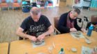 Hard at it: older people in Moray give pottery a go as part of an innovative new project.