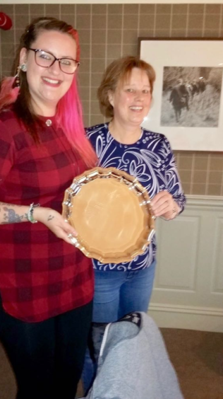 Fiona (right) receives the 'Citizen of the Year' Award from previous holder Rachel Lewis of Action Kintore 'The Bothie'.