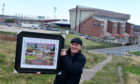George Dow with his commemorative painting of Pittodrie Stadium.