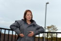 Councillor Avril MacKenzie next to the street lights.  Picture by KENNY ELRICK