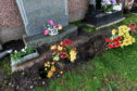 Wilma Haggart noticed her son's grave is sinking at Grange Cemetery, Peterhead.  Picture by KENNY ELRICK