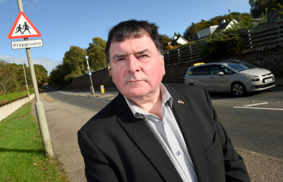 Councillor Ken Gowans on Culloden Road, Inverness calling for more investment in Crossing Patrollers in the city.