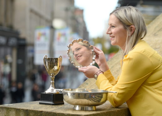 Claire Macaulay of Glasgow and Ness, Lewis, winner of the Mary C MacNiven Memorial Salver, Mr and Mrs Archibald MacDonald Memorial Trophy and the Joyce Murray Trophy in the Oran Mor.