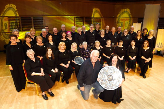 Picture by SANDY McCOOK   18th October '19 Royal National Mod, Glasgow 2019 (Friday).  Sileas Sinclair, Conductor of the Oban Gaelic Choir with the Lovat and Tullibardine Shield for Choral singing with her choir. Also in the foreground is Brendan Graham from Ireland who wrote their winning own choice entry.