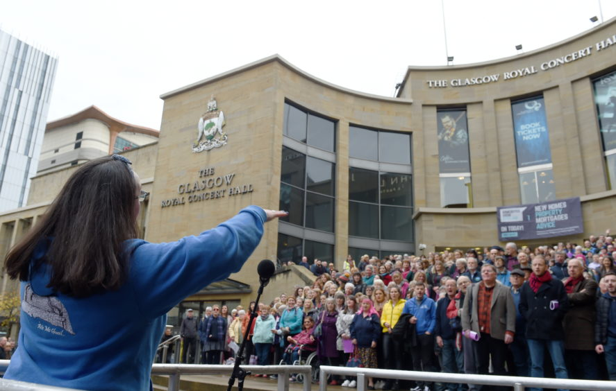 The Massed Choirs perform on the steps of the Royal Concert Hall in Glasgow as the 2019 Mod comes to an end. Picture by Sandy McCook