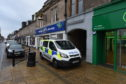 Police at the scene on Nairn High Street after a body was found.