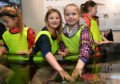 MACDUFF PRIMARY PUPILS GRACIE GIBB (L) AND SOPHIE INGRAM TRY OUT THE  NEW TOUCHING POOLS AT MACDUFF AQUARIUM