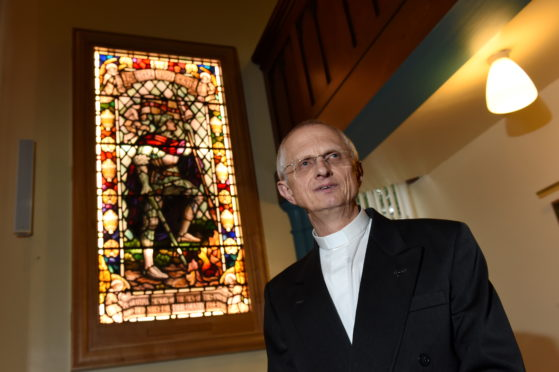 Rev Martyn Sanders held a rededication service for the stained glass window. Picture by Kenny Elrick.