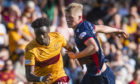 Motherwell's Devante Cole in action with Ross County's Tom Grivosti during the Ladbrokes Premiership match between Motherwell and Ross County at Fir Park.