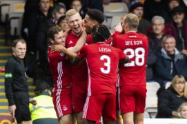 Sam Cosgrove is pictured celebrating with his teammates after making it 1-0 to Aberdeen at Motherwell
