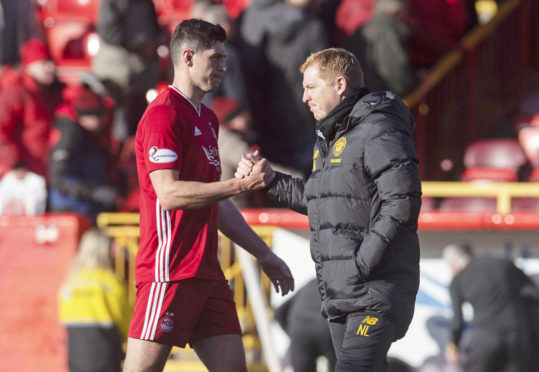 Scott McKenna with Neil Lennon after Aberdeen's defeat to Celtic.