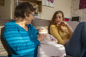 Maria receives support from a Home-Start volunteer Michele with her four children.