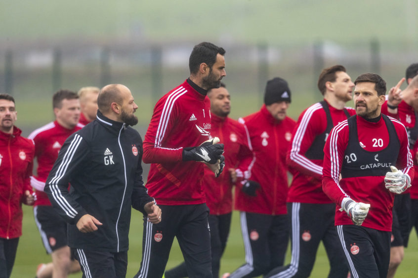 Joe Lewis leads the team in their warm-up.