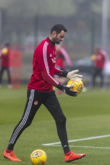 Keeper Joe Lewis practising his kicking.
