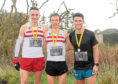 Peterhead 10km top three. Left to right, 2nd Myles Edwards,  1st James Hoad and 3rd Richard Strachan.   Picture by Kath Flannery