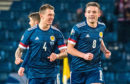Scotland's John McGinn celebrates with Ryan Jack (left) after he scores a free kick to make it 1-1 during the UEFA European Championship Qualifier between Scotland and Kazakhstan.