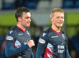 Ross County's Sean Kelly (L) and Tom Grivosti