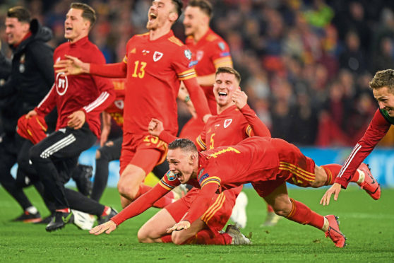 Wales celebrate qualifying for Euro 2020 after their 2-0 win over Hungary.
