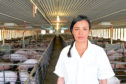 HOST: Presenter Liz Bonnin pictured in an intensive pig shed on a US farm in Meat: A Threat To Our Planet?