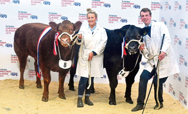 Rebecca Stuart with the overall champion, Cinnamon, and William Moir with the reserve champion, Gazza.