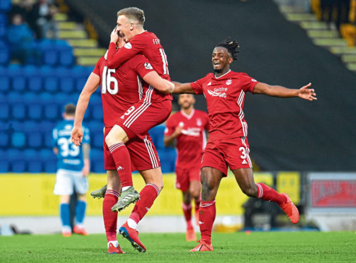 Sam Cosgrove celebrates with Lewis Ferguson and Greg Leigh after making it 1-0 to Aberdeen during the Ladbrokes Premiership match between St Johnstone and Aberdeen at McDiarmid Park.