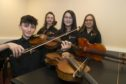 28/11/19   L-R William Hodi,Charlotte Slater ,Sienna Lee and Ariana Black,   Four pupils at Aberdeen City Music School are to play at the prestigious BBC Sports Personality of the Year event dinner next month.The awards, which have been a much-loved landmark in the UK's sporting calendar since 1954 are making their Aberdeen debut at the new P&J Live venue on Sunday 15 December.The school's talented string ensemble, comprising students Ariana Black, William Hodi, Charlotte Slater and Sienna Lee, will entertain the corporate audience before they head into the main show with a 30-minute programme performed during the award's pre-dinner.