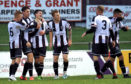 Rory MacEwan celebrates his goal with Elgin City team-mates.