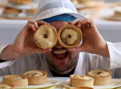 Outlander star Scott Kyle helps judge the entries during the search for the 2020 World Scotch Pie Champion at Carnegie Conference Centre, Dunfermline.