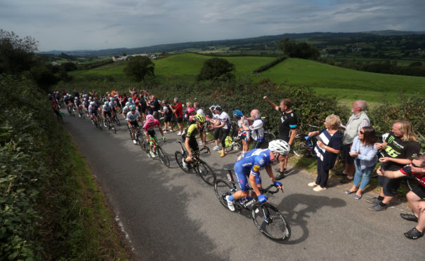 The Peloton takes the first King of the Mountain climb up Bethleham Hill during stage one of the Ovo Energy Tour of Britain 2018 from Pembrey Country Park to Newport.