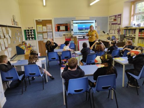 Pupils using the VR headsets at Daviot Primary.