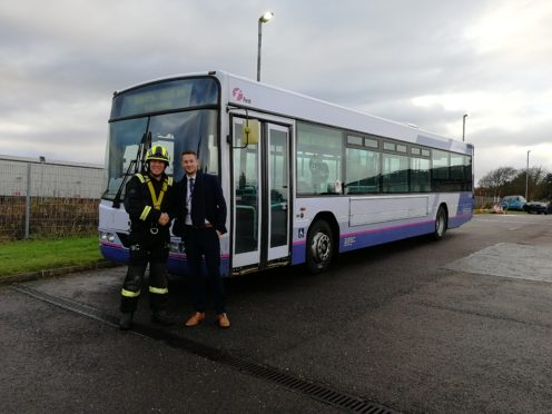 Michael Smith from First Bus with Gary McArthur, SFRS Station Commander at Portlethen Training Centre