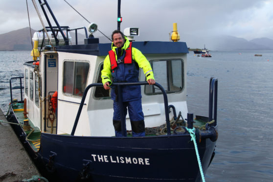 Alan MacKellar on the Lismore ferry at the jetty in Port Appin
